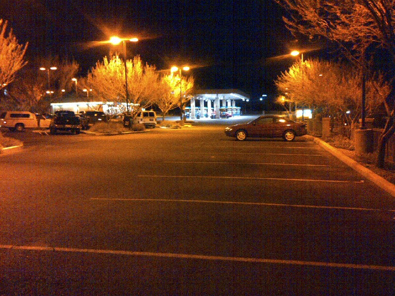Shopping mall parking lot - LPS lighting with halide lighting in adjacent property & Category: Lighting - SAFEGROWTH INSPIRE NEIGHBORHOOD FUTURES azcodes.com